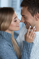 Portrait Of Happy Beautiful Couple. Woman Touching Handsome Man
