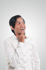 Happy Young Asian Businessman Thinking