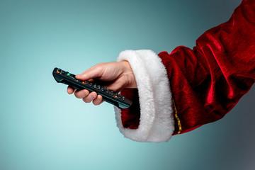 Santa Claus holding tv remote control