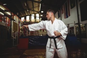 Karate player practicing with nunchaku
