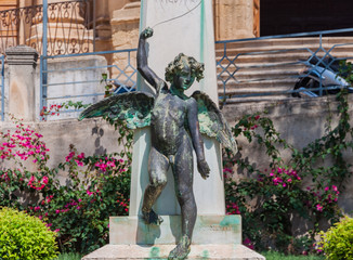 Sculpture of an angel on a street in the old city center in Noto, Sicily