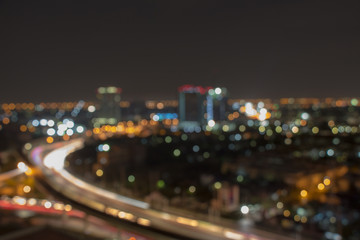 Blurred city skyline at night for corporate business concepts and urban city planning. Skyscrapers at twilight.