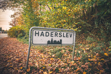 Haderslev city sign by a road in Denmark