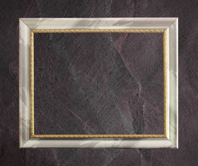 antique frame isolated on Dark grey black slate background or te