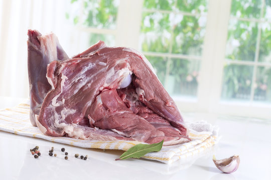 Shoulder of lamb isolated on a white studio background.