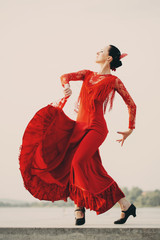 Flamenco dancer Spain womans in a long red dress