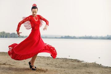 Flamenco dancer Spain womans in a long red dress