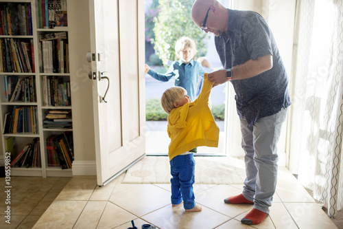father dressing up son while standing at home stock photo and royalty free images on fotolia. Black Bedroom Furniture Sets. Home Design Ideas