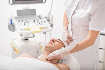 Female cosmetologist undergoing laser therapy
