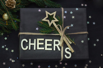 Stylish Сhristmas, New Year gift wrapping composition cheers with a deer and a branch of fir