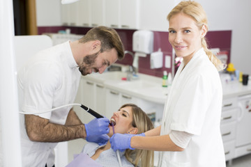 Young woman getting dental treatment in dentist office