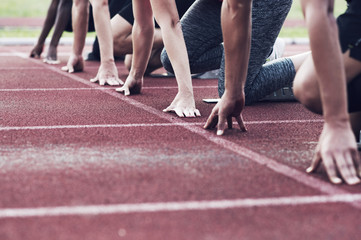 Runners poised at starting blocks on track