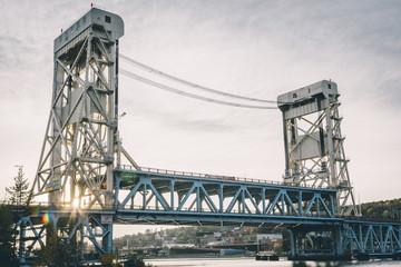 Portage Lake Lift Bridge against sky during sunset