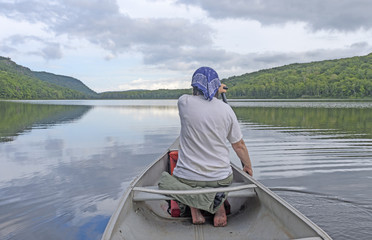 Barefoot Paddler on a Calm Lake