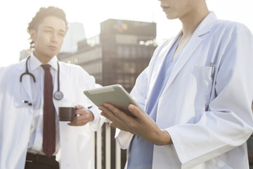 Two doctors are talking on the rooftop