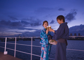 Couple in yukatas toasting