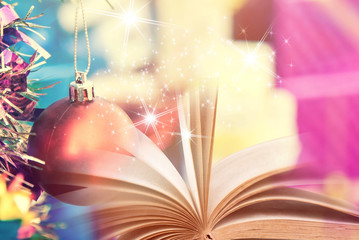 Open book with Christmas background
