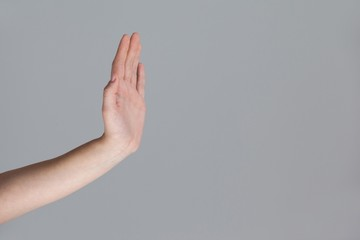 Hand of a woman showing stop sign