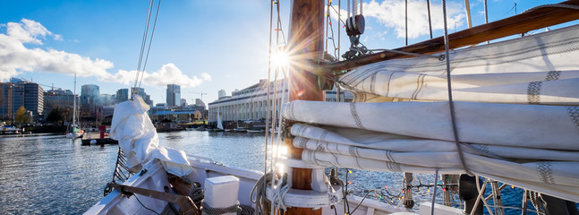 Seattle sailing on Lake Union in a vintage yacht sailboat. Sun flare on mast