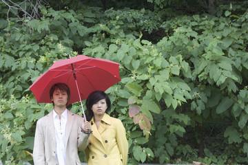 Friends holding umbrella