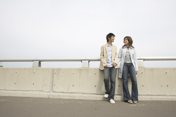 Young couple standing on the road
