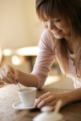 Smiling young woman at cafe