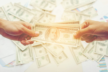 Handling cash between two people , business concept