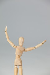 Wooden figurine standing with arms spread wide