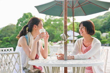 Women talking with each other at garden table