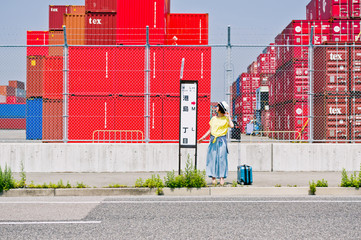 Woman standing at the bus stop