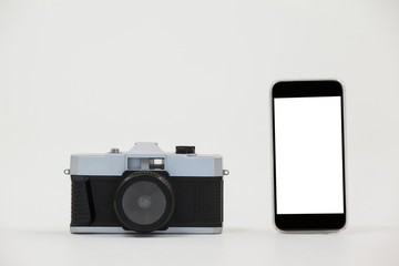 Close-up of camera and smartphone