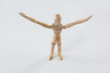 Wooden figurine standing with arms spread
