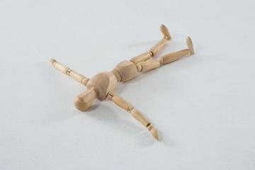 Wooden figurine lying on floor