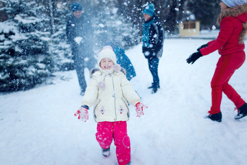 Active leisure with children in winter on cold days.