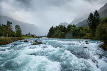 Foto op Aluminium Rivier Misty landscape with Oldeelva glacier river in Norway