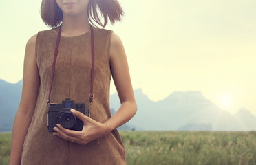 Hipster Traveler with backpack and taking photo of amazing lands