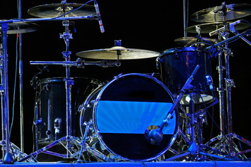 Drum set with bass drum, tom-toms, cymbals and microphones