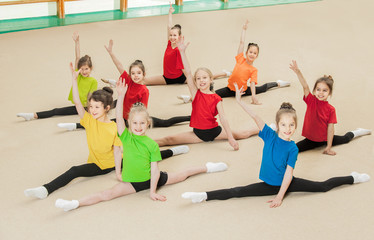 Group of happy active children in gym