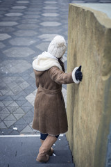 Young woman on stairs outside with hand streched
