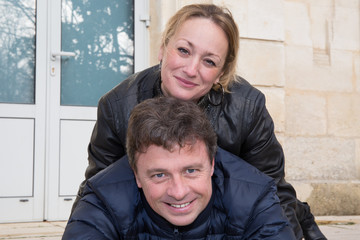 a lovers couple, middle aged in winter, blond woman