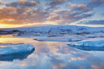 Icebergs in Jökulsárlón glacier lake at sunset