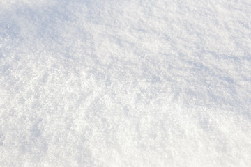 Background, texture, white fluffy snow, different depth of field