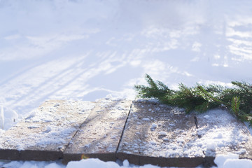 Spruce branches on a winter background with blurred bright light