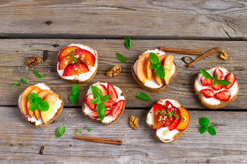 Summer colorful bruschetta appetizer with fruit, curd cheese and