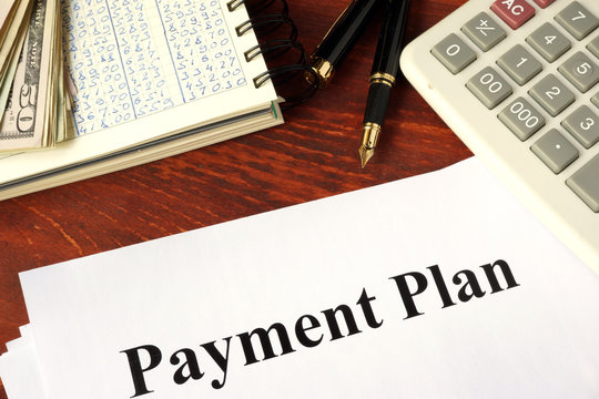 Papers with title payment plan. Business concept.
