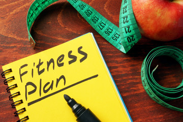 Fitness plan written in a note. Healthy lifestyle concept.