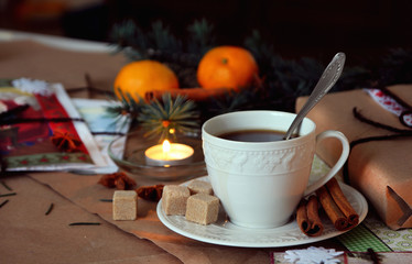 A cup of hot coffee on the background of Christmas decorations..