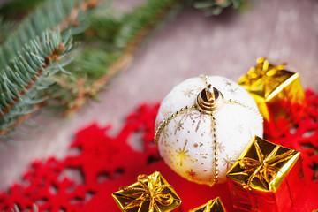Christmas ball, gift boxes and fir tree branch