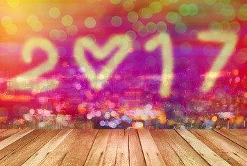 happy new year 2017 with bokeh and wooden pattern in colorful color style background,Double exposure.
