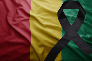 flag of guinea with black mourning ribbon